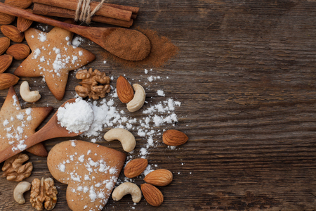 Biscuits and nuts on a wooden background Stok Fotoğraf