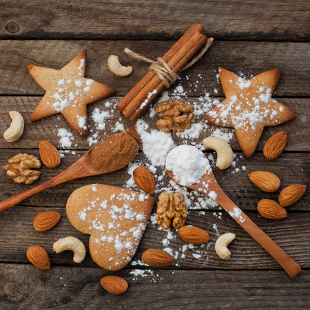 Biscuits and nuts on a wooden background Reklamní fotografie