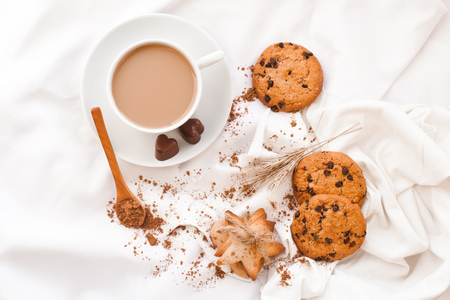 Coffee in a cup and sweets on a white cloth Reklamní fotografie - 93648221