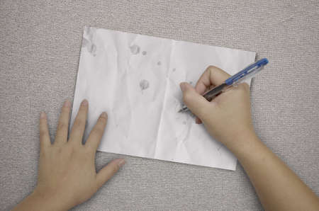 hand writing in paper on fabric background photo