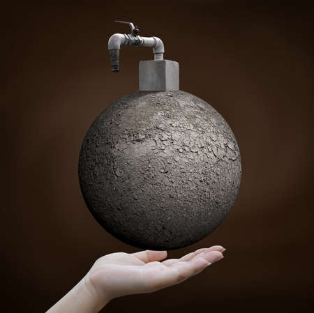 save earth: hand holding arid world with faucet Stock Photo