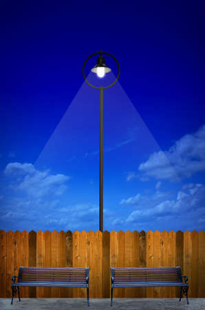 street lighting with bench and wooden fence photo