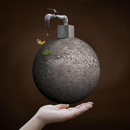 conservacion del agua: mano sosteniendo mundo �rido con grifo
