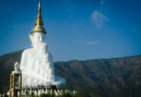 golden crown: White Buddha statue with the golden crown, North of Thailand Stock Photo