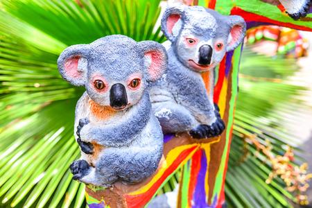 Koala statue on a branch in the garden