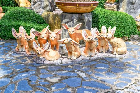 Ten Foxes Statue Like Cartoon In The Garden Stock Photo, Picture And  Royalty Free Image. Image 67483792.