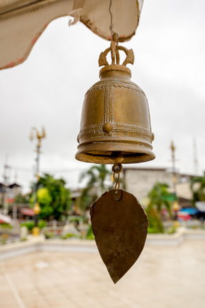 Golden Bell hanging with gold Bo Leaf in Thai Temple