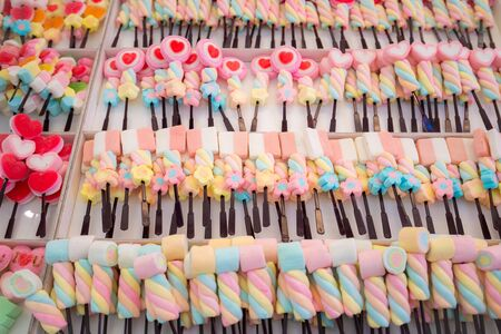 Colorful Marshmallows Stick in the white box, the candy sweet for kids 写真素材