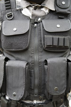 tactical: black S.W.A.T vest - part of soldiers equipment Stock Photo