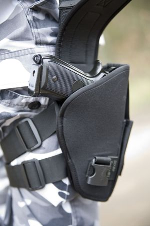 holster: gun holster with a 9mm weapon inside Stock Photo