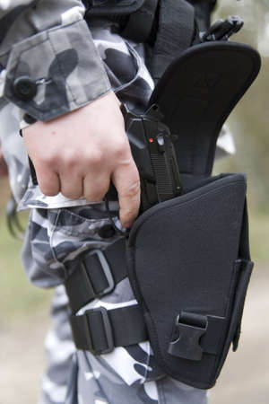 sidearm: gun holster with a 9mm weapon inside Stock Photo