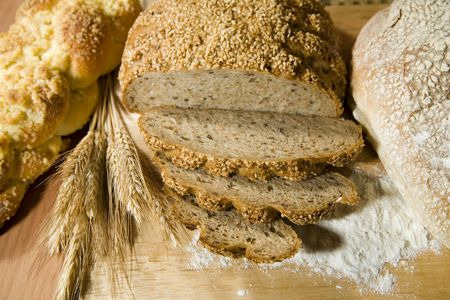 three kinds of fresh, well smelled bread and a wheat photo
