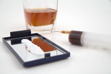 junkie: syringe, cocaine and a glass of whiskey