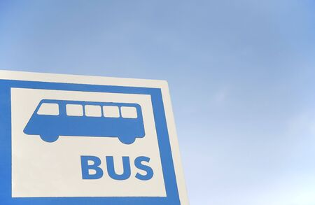 bus stop sign over the blue sky photo