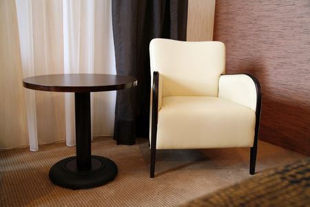 comfortable chair: brown table and comfortable chair