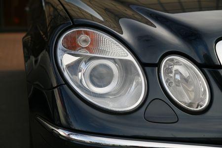 headlamp of a new car in dealer salon Standard-Bild