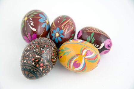 whie: five painted eggs on whie background