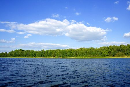 blue sky with white clouds over blue water (Poland) photo