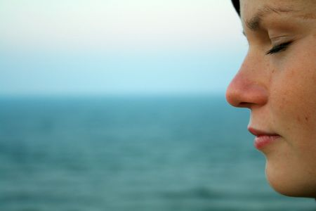 thoughtful wooman at the seashore