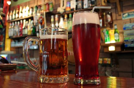 mug and a glass of beer by the bar