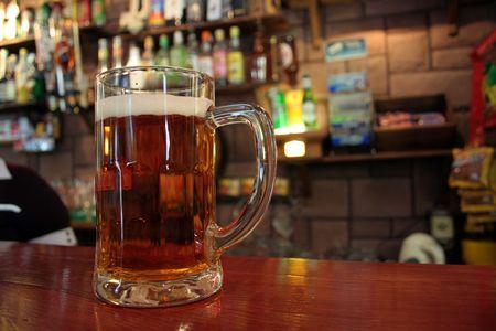 boozer: mug of beer on the bartop