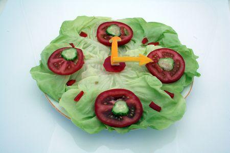 salad clock on white background photo