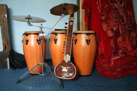 ancient yoga: old sitar and three bongos