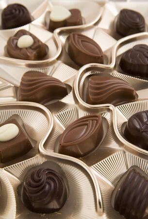 satisfying: chocolate box full of tasty candies Stock Photo