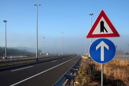 signs in foggy motorway in Croatia Standard-Bild