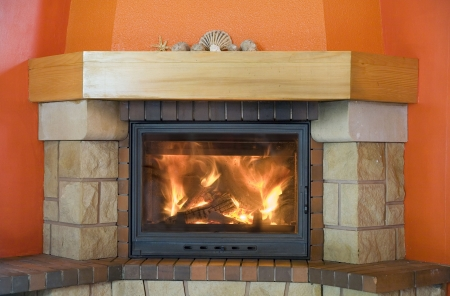 stone fireplace: red fireplace with a small hell inside Stock Photo
