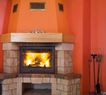red fireplace with a small hell inside photo