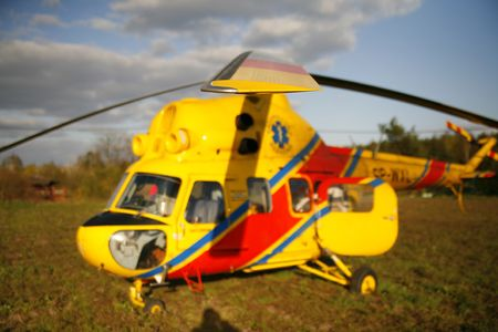 airfoil: rescue helicopter landed on the grassy field