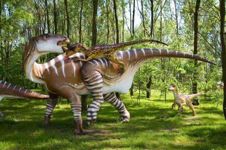 Jurrasic park - set of dinosaurs - fight between Iguanodon bernissartensis and Deinonychus antirrhopus photo