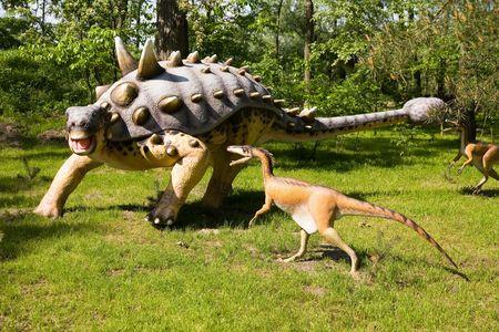 carboniferous: Jurrasic park - set of dinosaurs - fight between Euoplocephalus tutus and Troodon formosus Stock Photo