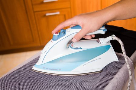 ironing the suit through a special fabric photo