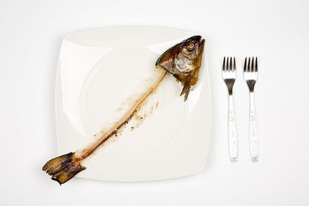 eaten fish with head and tail - symbol of misery Standard-Bild