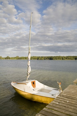 swimm: a small yacht is waiting for good wind Stock Photo