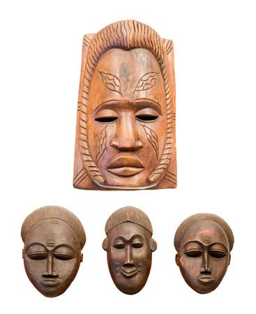 wood craft: four african masks isolated on white background