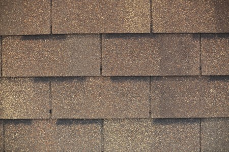 fragment of roof shingle - perfect background Stock Photo