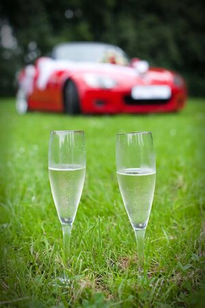 champaign: two champaign glasses on red car background