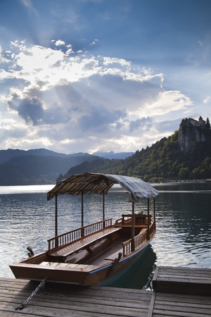 Boat on the Bled lake in Slovenia - one of the most beautiful regions of Julian Alps photo