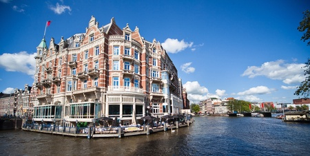 amsterdam canal: one of the most beautiful buildings in Amsterdam  Editorial