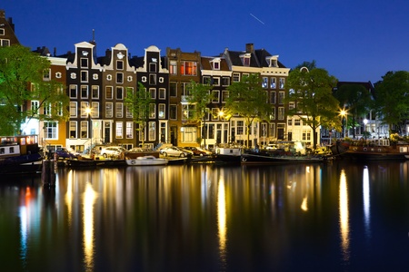 suggests: lovely houses in Amsterdam center- photo taken in the late evening - star suggests long exposure time