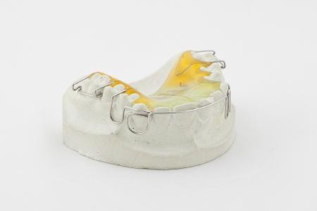 bridgework: Dental plate on white background