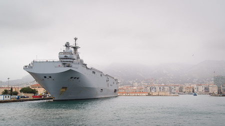 destroyer: French navy Mistral class helicopter carrier in Toulon harbour Editorial
