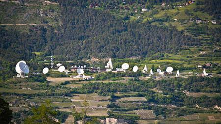 Plenty of satelite antennas in Switzerland mountains photo