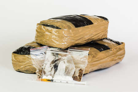 criminal: Drug packages isolated on white background