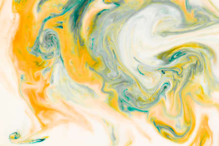 Artistic abstract design created with mixing color liquids. Colorful background texture. Liquids mixing on water surface.