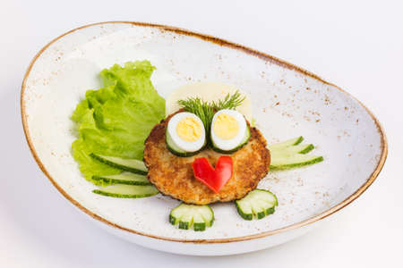 flesh eating animal: Cutlets with mashed potatoes and lettuce. On white background Stock Photo