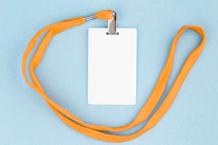 Empty ID card / icon with an orange belt, on a blue background. Space for text. Stock Photo
